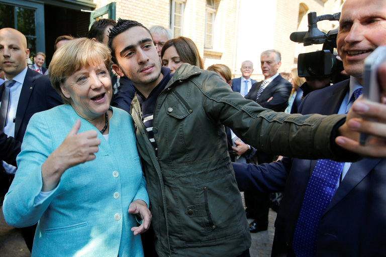 Syrian Refugee Labelled Terrorist After Selfie with GermanChancellor